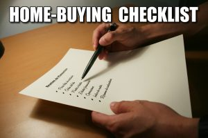 "hands, Pen and checklist featuring the words""Home Buying Checklist"""
