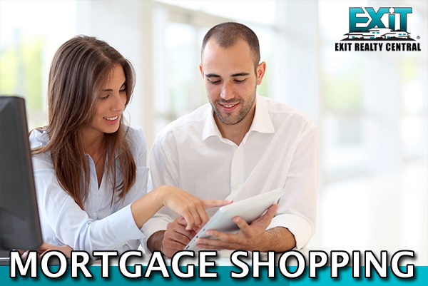Man and woman holding papers shopping for a mortgage in Coastal Virginia