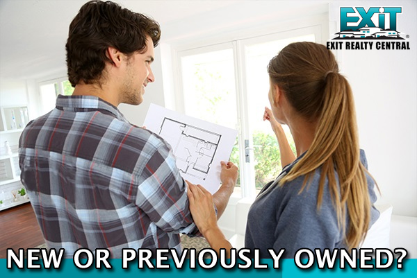 Man and woman looking at a paper deciding new orpreviously owned home in coastal virginia