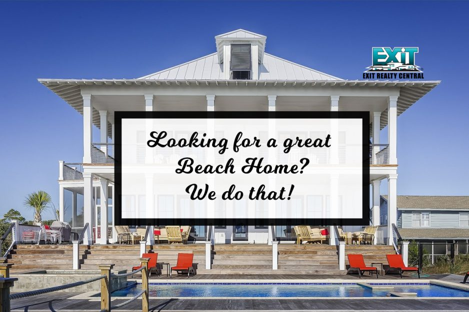 Looking for a great beah home? We do that sign with beach home in the background