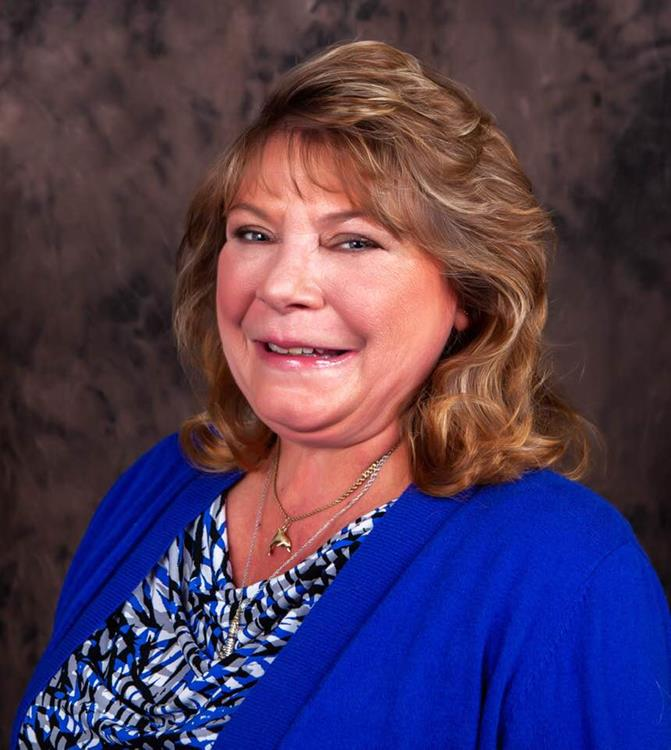 Portrait of Sara Vaughn, Realtor®!
