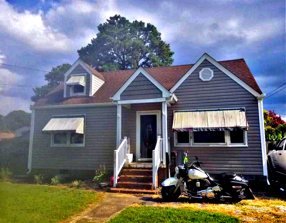 Front of property located at 2741 Greenwood Drive, Portsmouth, VA 23702. The levels are adjusted on this picture,