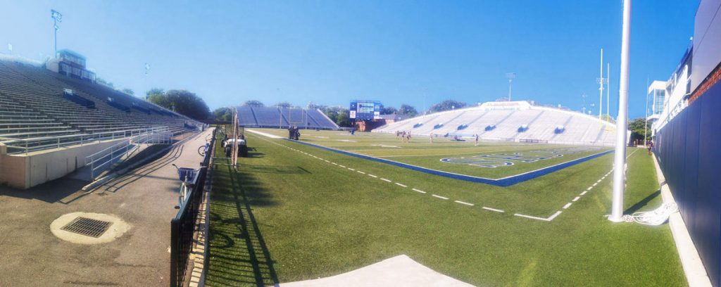 Panorama of Foreman Field at Old Dominion University showing grass, football field, stands and bleachers.
