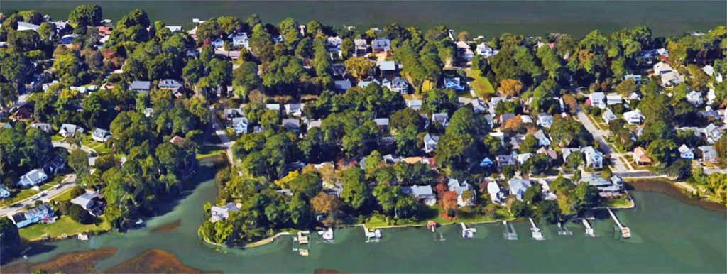 Aerial view of the Larchmont neighborhood showing houses, piers, water.
