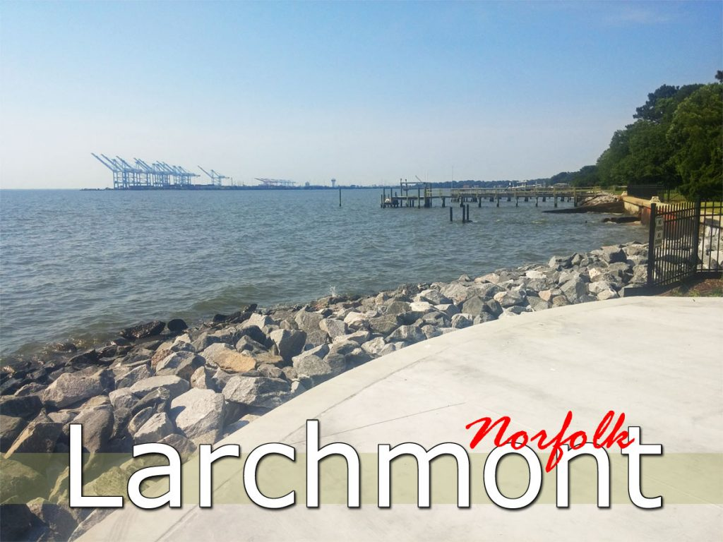 Water view from the Larchmont neighborhood with sidewalk, bulkhead stones, and piers.