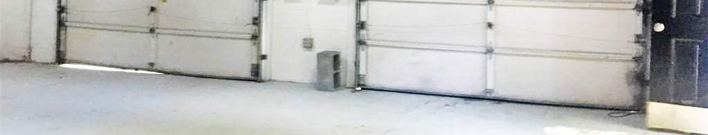 Garage Doors and Floor of property located at 322 Lakeside Boulevard, Richmond, Virginia 23227