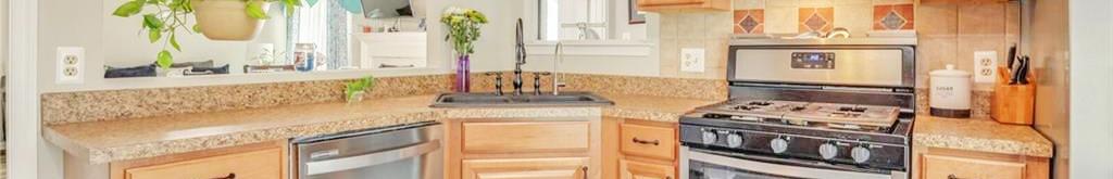 Kitchen in property located at 222 Abingdon Court, Suffolk, Virginia 23434